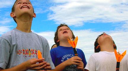 Photo, Kids watching rockets at the Summer Adventure, LANL site