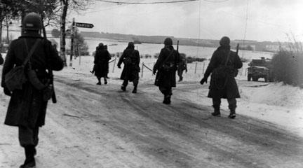 Photo, The 101st Airborne troops move out of Bastogne. . . , 1944, U.S. Army