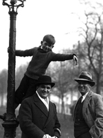 Photo, MacJannet student up a lamp post as Emory Foster, ca. 1930, 1930