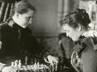 Photo, Helen and Anne playing chess, 1900, American Foundation for the Blind