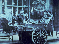 Photo, Pushcart peddler in Lower East Side, NY, early 1900s, The History Box
