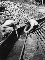 Photo, Two men searching for gold in a sluice flume, Thar's Gold in. . . site