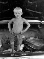 "Photo, ""Small boy in trunk of car with hands on hips,"" William Gedney, 1972"